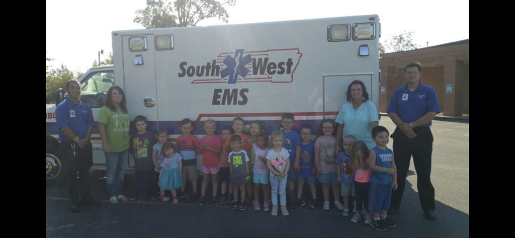 Mrs. Kim and Mrs. Amanda's Class taking a group picture during the Southwest EMS visit