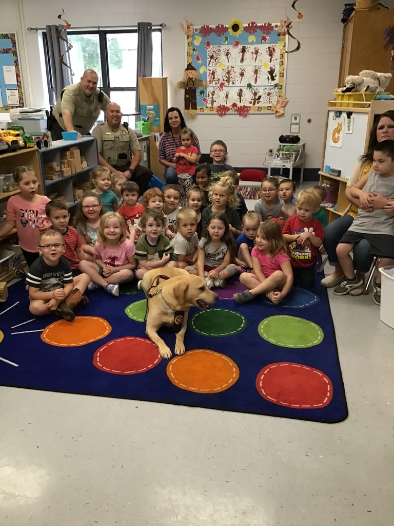 K-9 Officer Otto taking a picture with Mrs. Kim and Mrs. Jeannie's preschool classes along with Deputy Gibbons and Officer Harvey